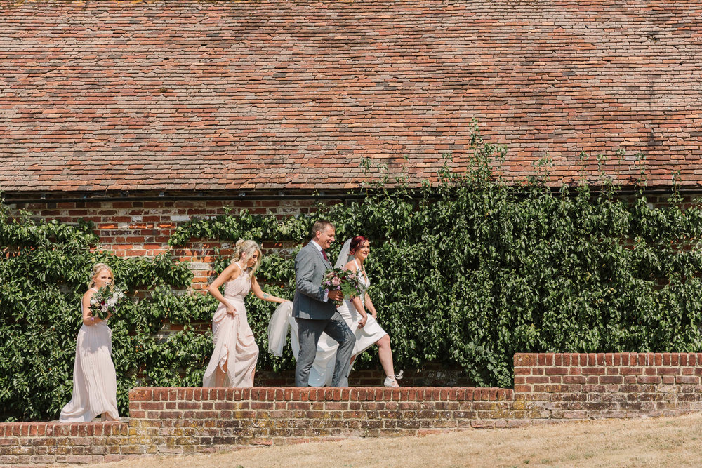 bride and dad walking towards aisle - ENGLISH COUNTRY WEDDING AT SWARLING MANOR