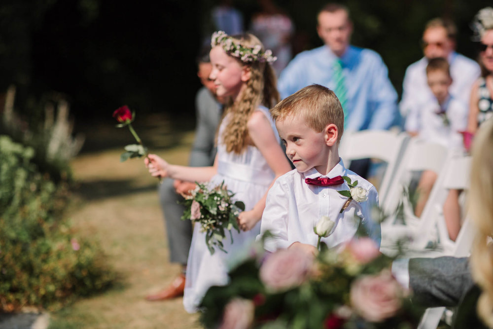 page boy and flower girl during outdoor ceremony
