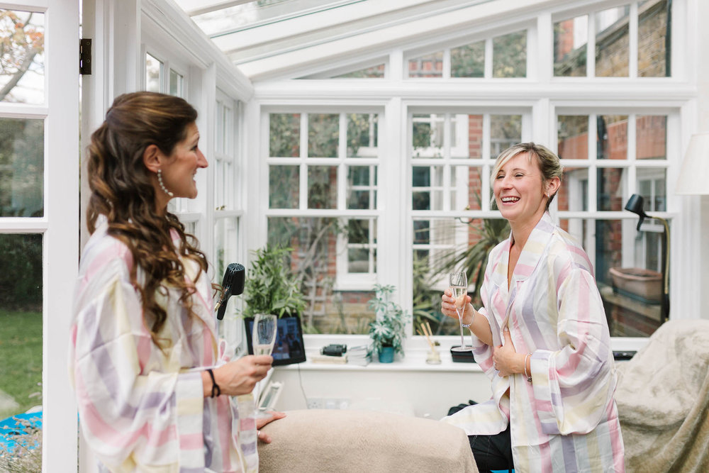 bridesmaids laughing during bridal prep