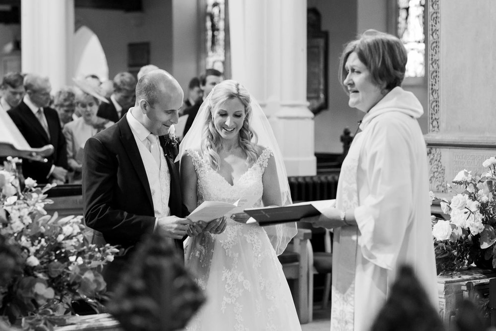 bride and groom singing hymn in church