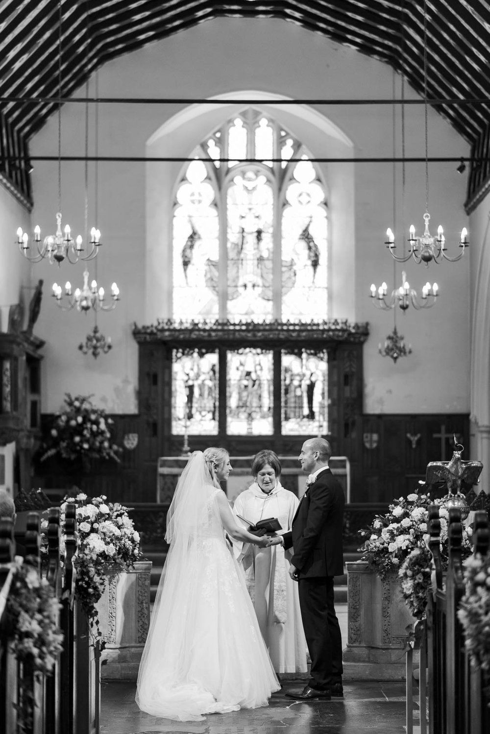 bride and groom during church ceremony - elegant london wedding