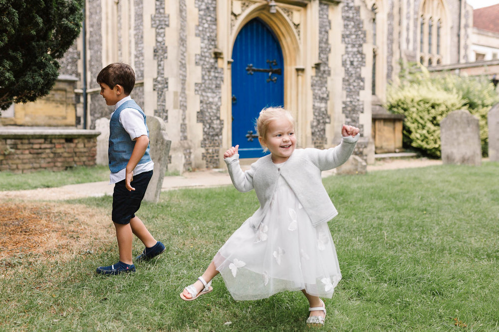 flower girl and page boy playing at the church