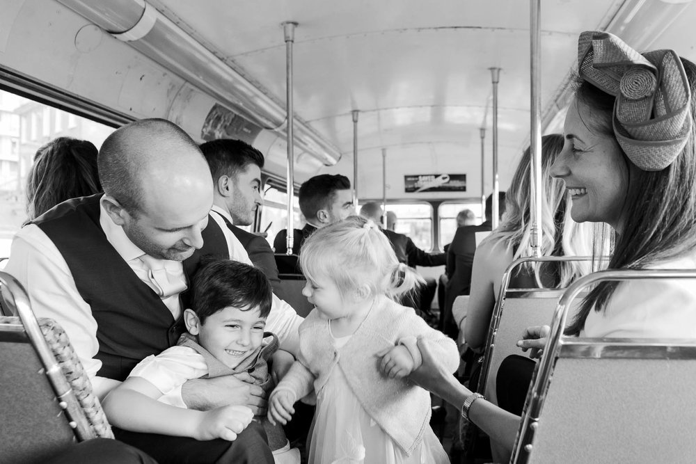 wedding guests on bus ride to venue