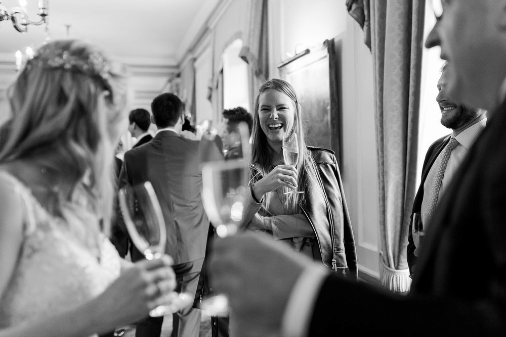 wedding guests drinking champagne and laughing