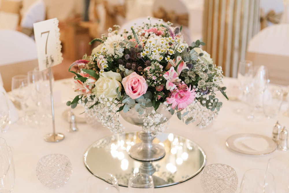 soft pastel flowers for centre piece - Elegant London Wedding at the Royal Automobile Club