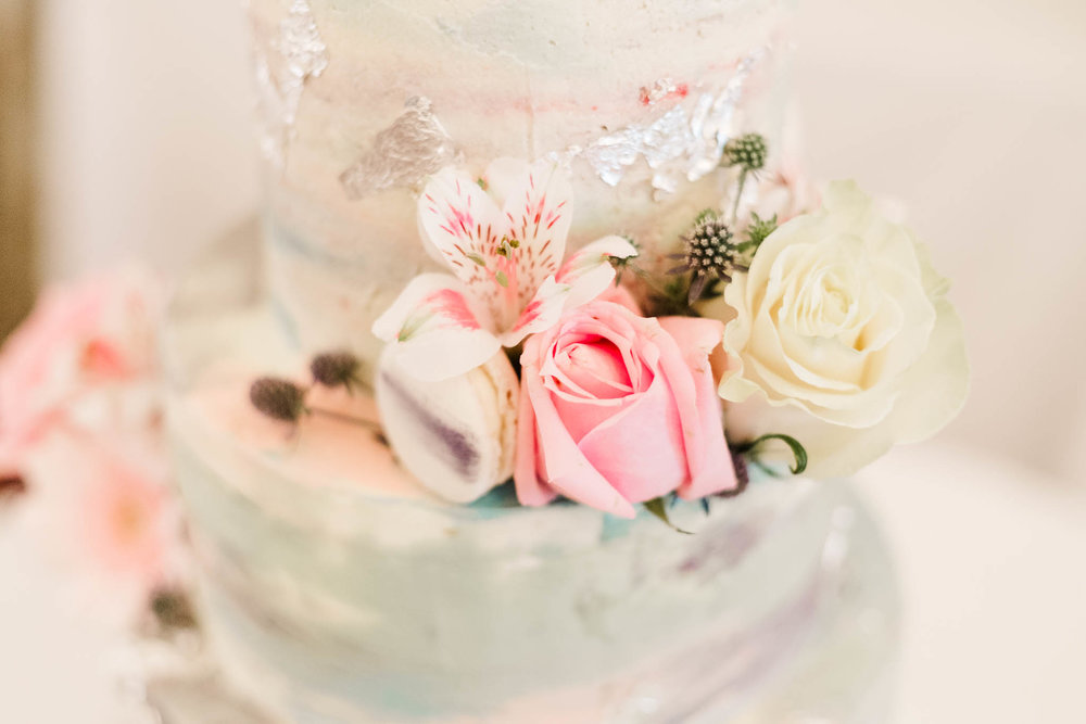 soft pastel flowers on wedding cake
