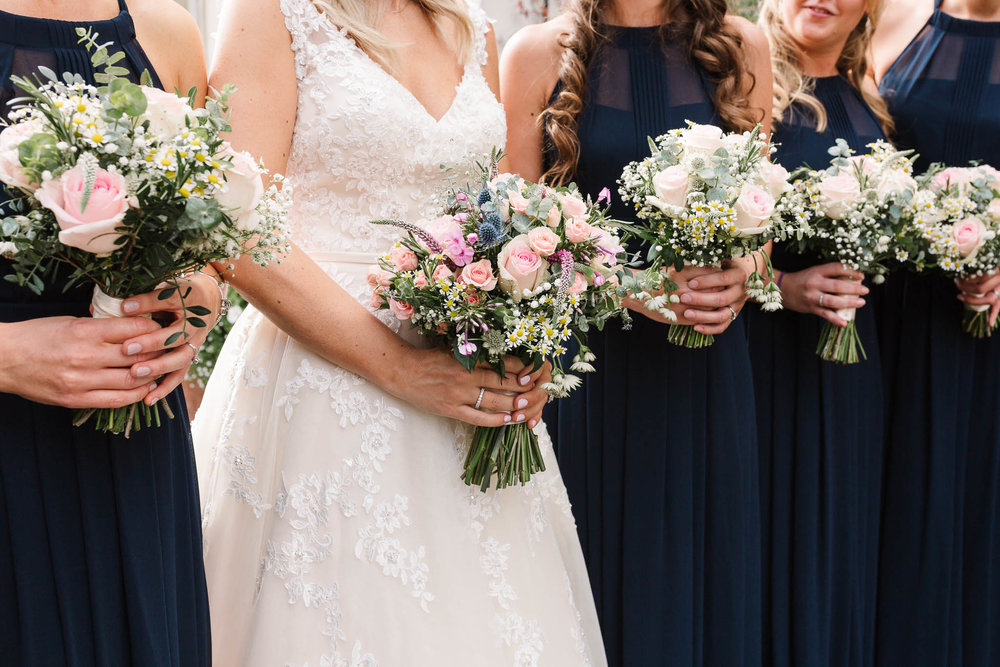bride and bridesmaids flowers - Elegant London Wedding at the Royal Automobile Club