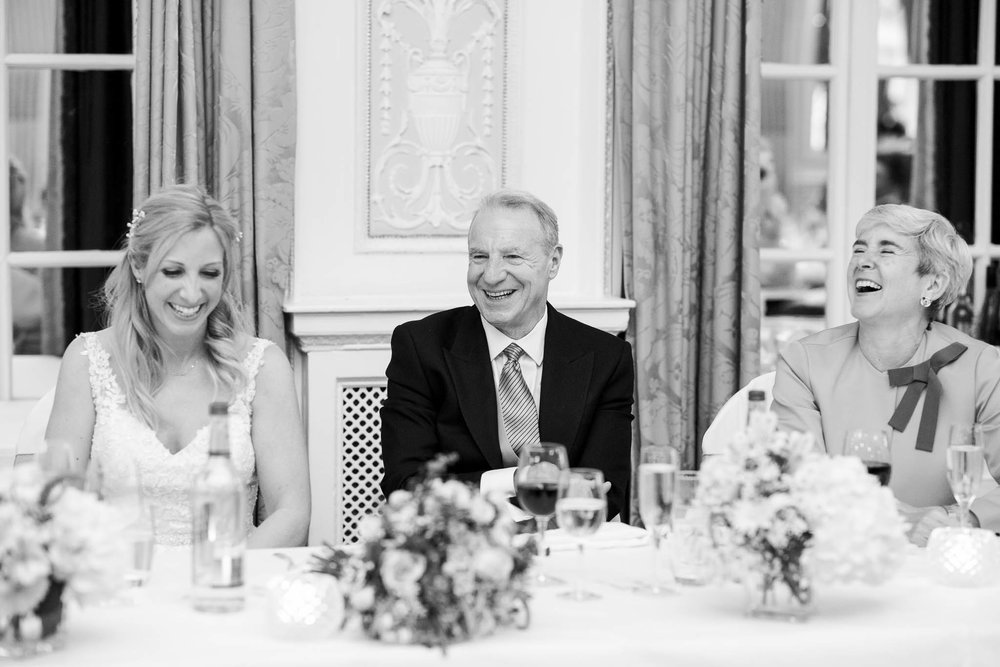 bride and parents laughing