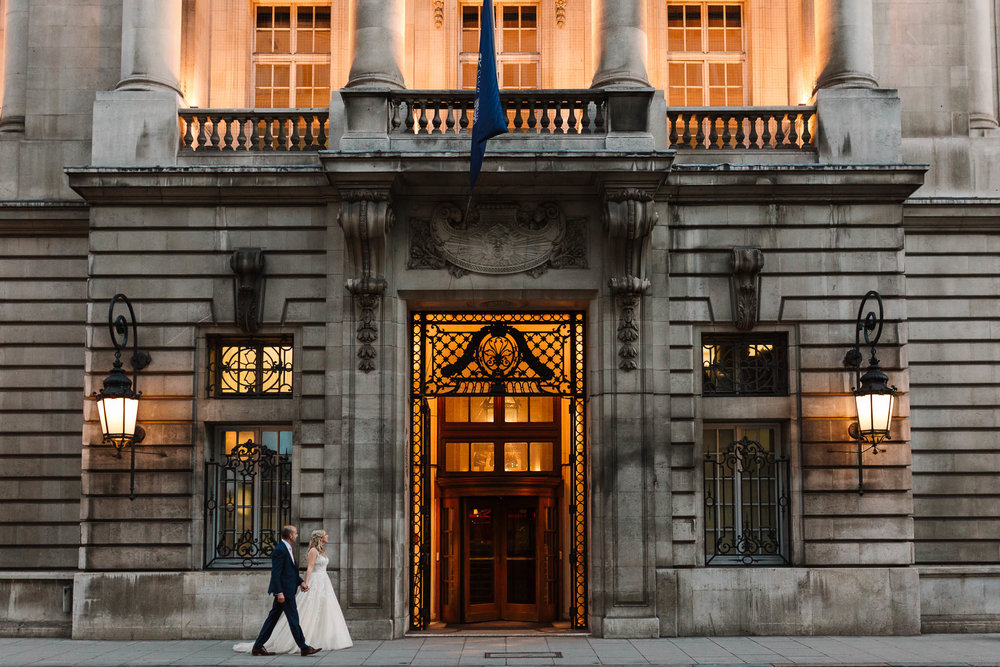 bride and groom entering RAC club wedding venue