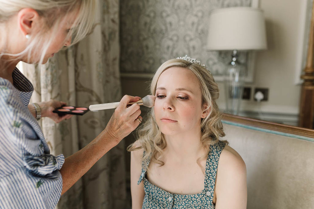bride having her make up done- Fun Country House Wedding