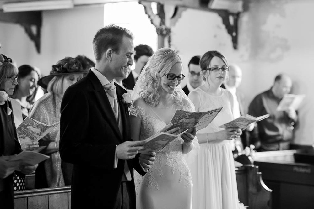 bride and groom singing hymns
