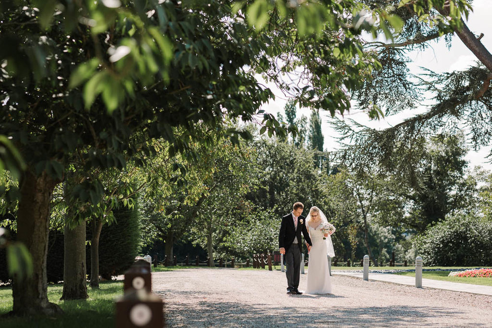bride and groom walking - Fun Country House Wedding