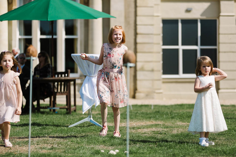 kids playing lawn games at Fun Country House Wedding