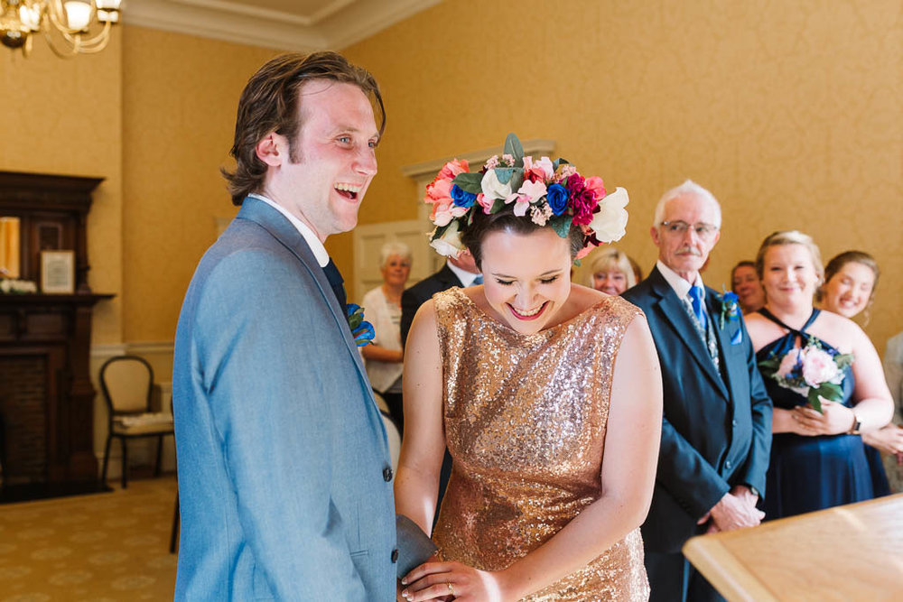 bride and groom laughing during ceremony  LANGTONS HOUSE WEDDING AND CHILLED GARDEN RECEPTION AT HOME