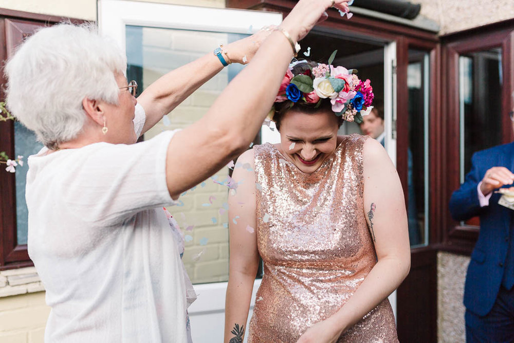 auntie throwing confetti over bride