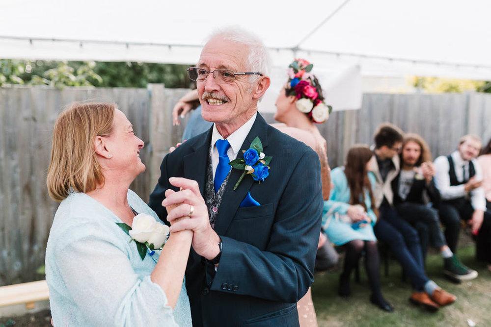 parents dancing at garden wedding
