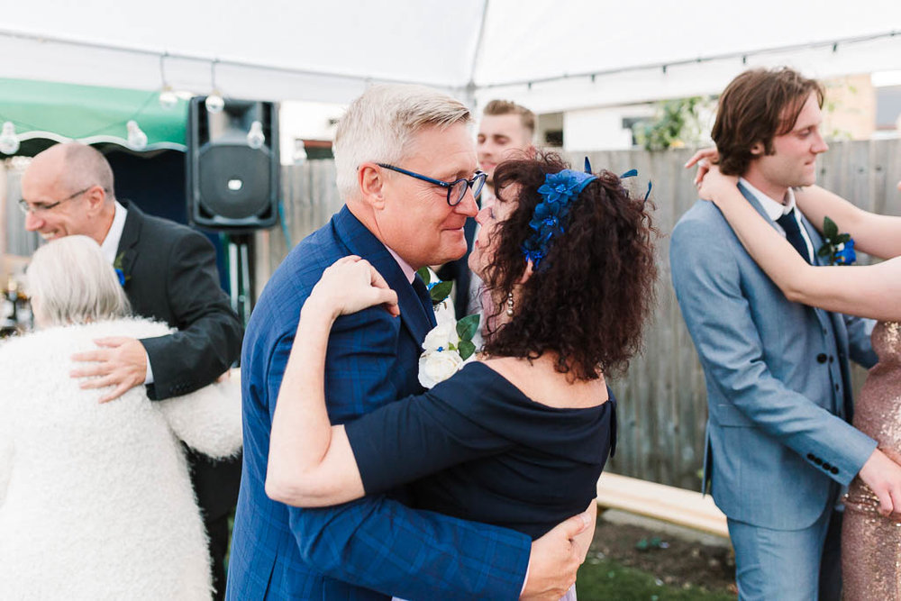 parents dancing at garden wedding