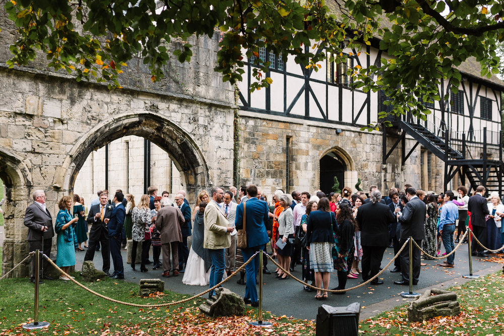 wedding guests gathered outside the hospitium