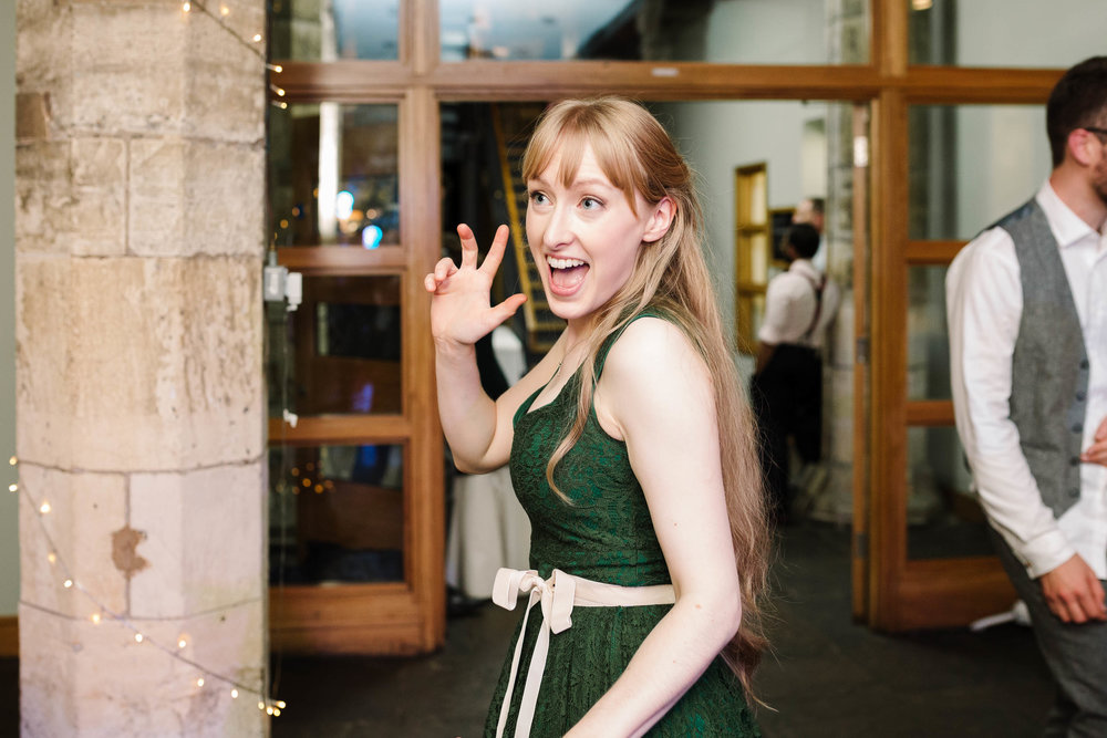 bridesmaid dancing at the hospitium