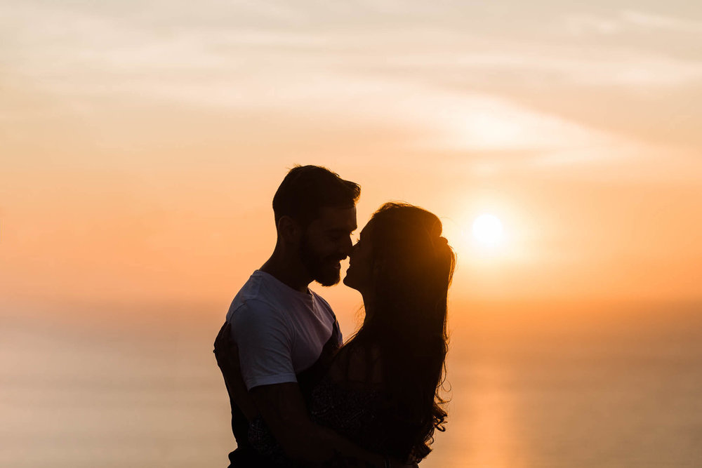 Couple's photo shoot on beach at sunset