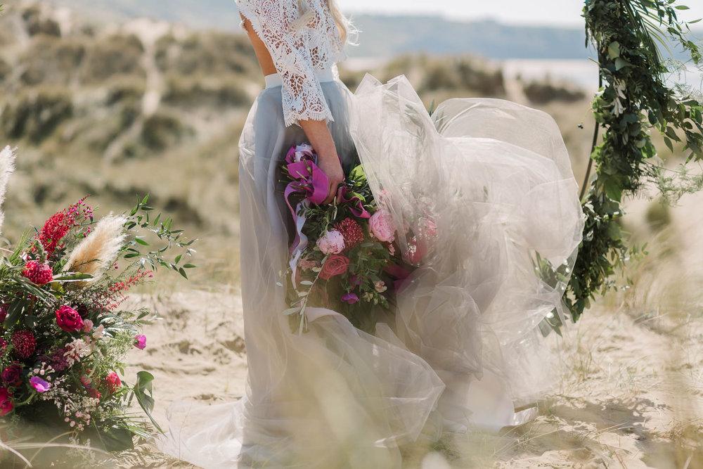 boho bridal bouquet and wedding dress