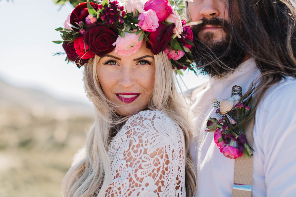 boho bride and groom with pink flower crown