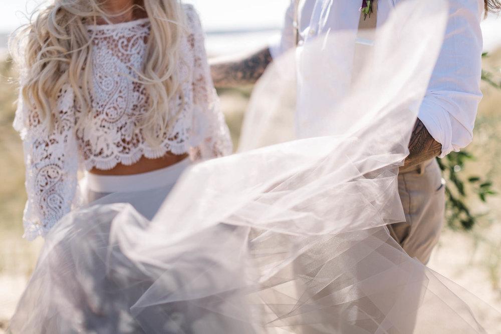 boho bride- wedding dress blowing in wind
