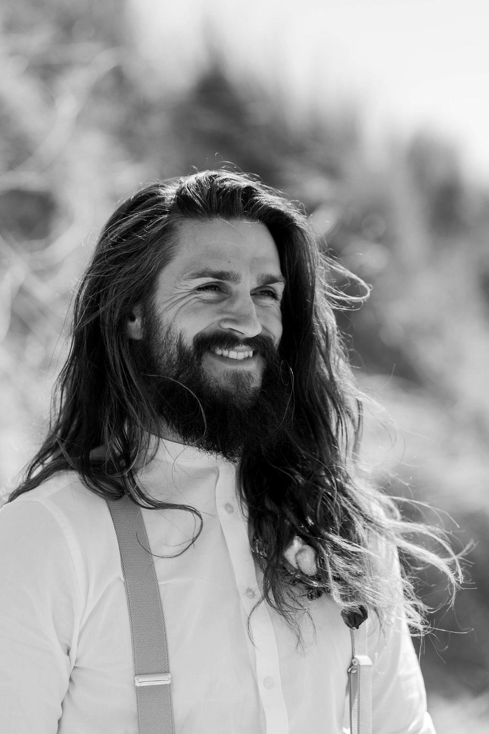 groom with long hair smiling
