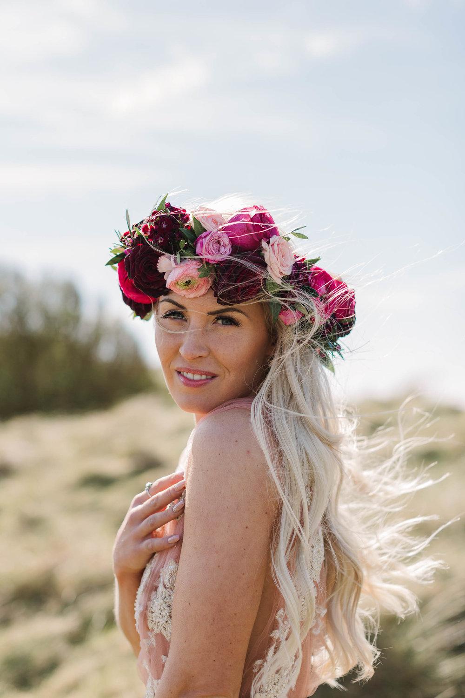 bride wearing a pink flower crown