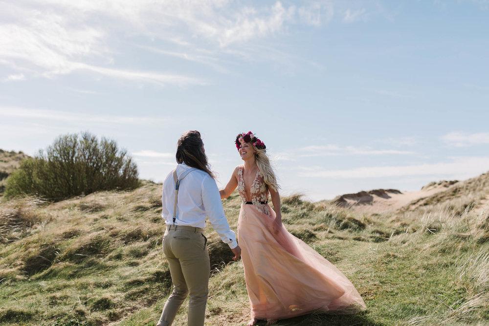 boho bride wearing pink wedding dress