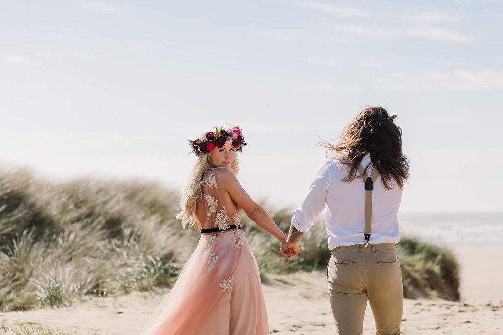 bride looking at camera with pink wedding dress
