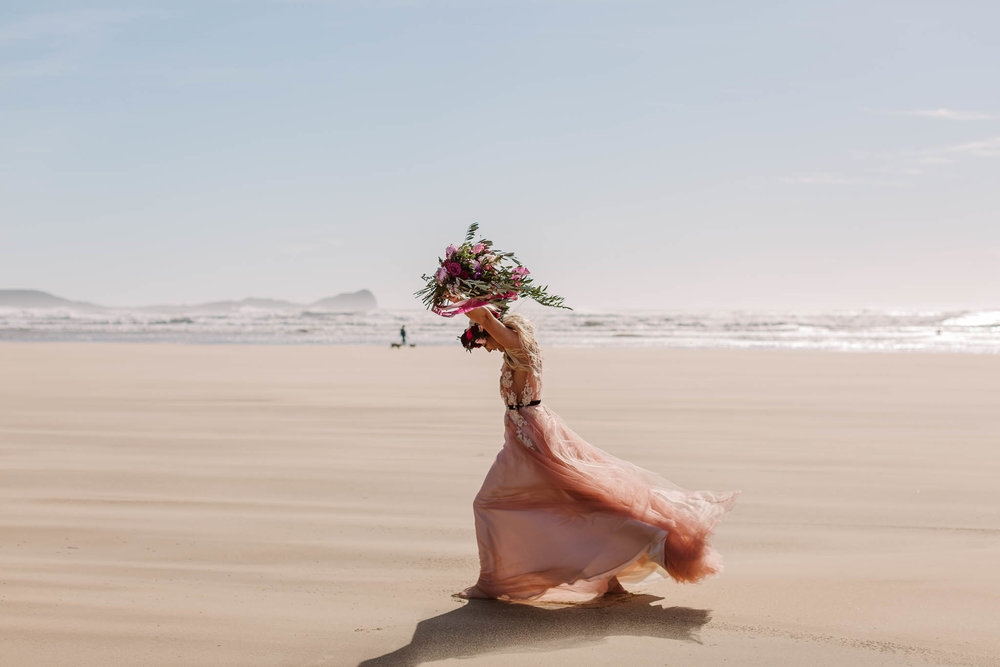 bride running on the beach