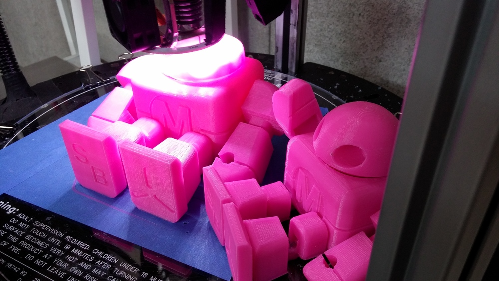 RostockMax is printing a robot. More detail about RostockMax here.