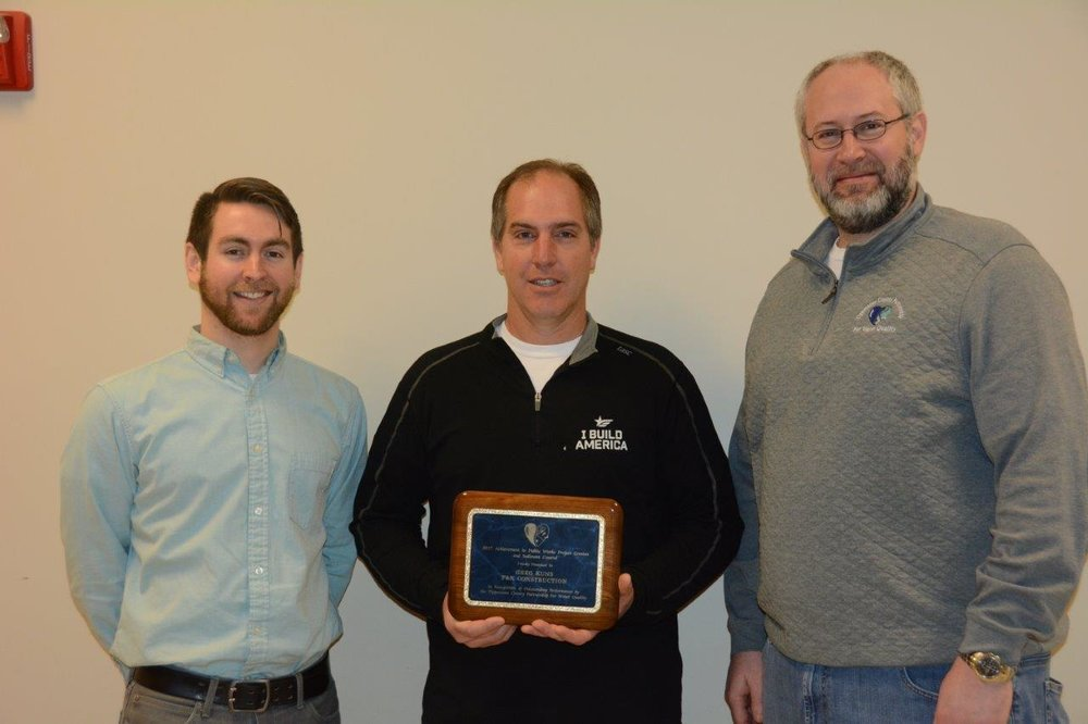 Pictured above: Marcus Smith of TCPWQ/ Chad Kuns of F&K Construction/Zach Beasley of TCPWQ