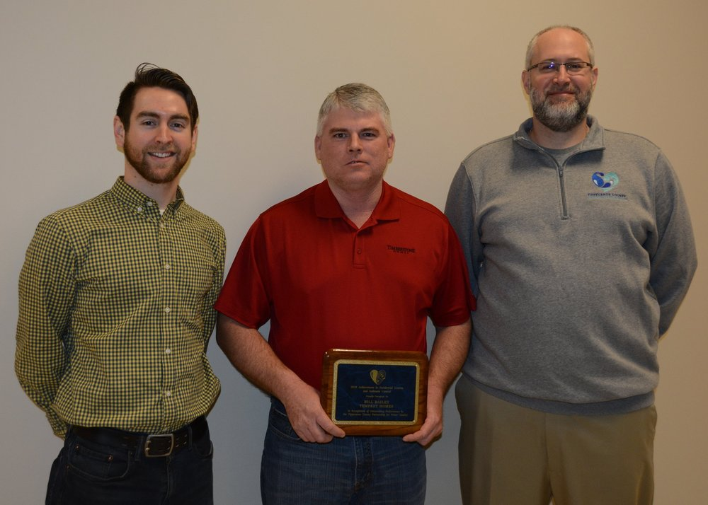 Pictured above: Marcus Smith of TCPWQ/ Bill Bailey of Tempest Homes/Zach Beasley of TCPWQ