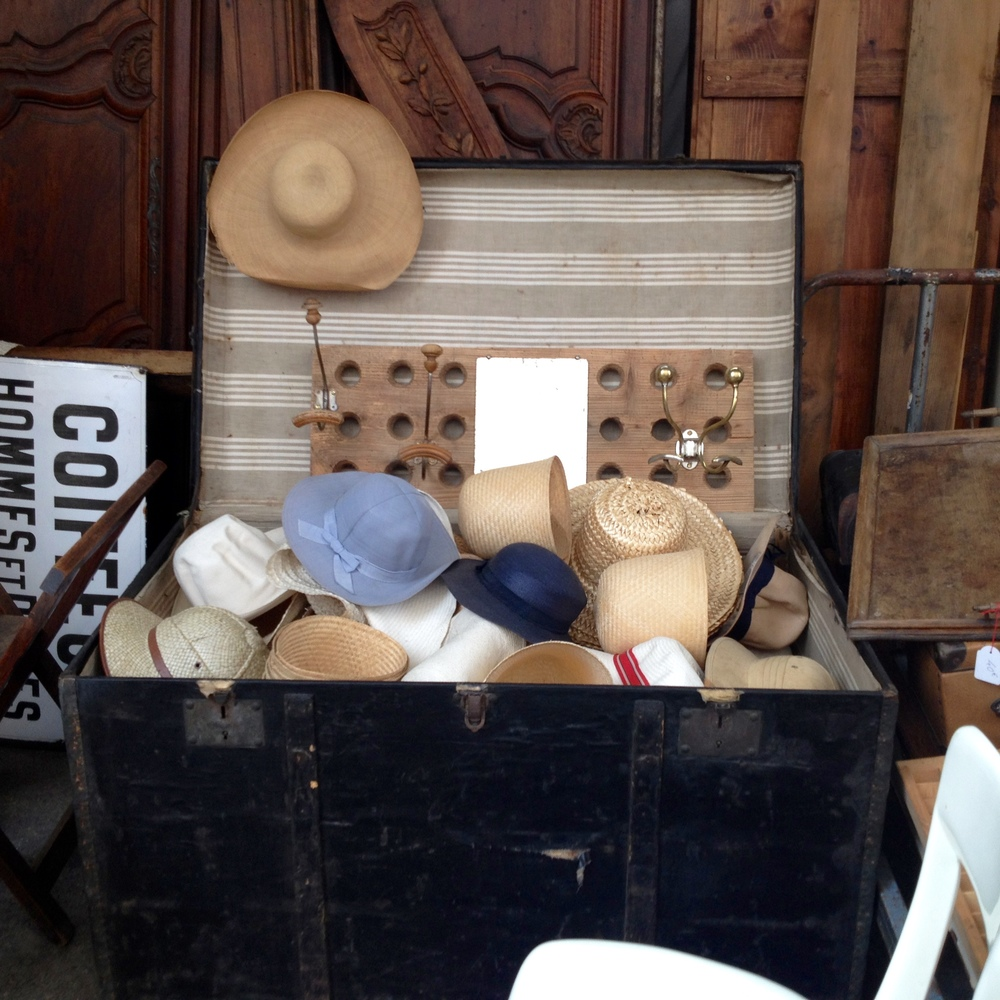 Trunk full of hats at l'Arrêt Deco.