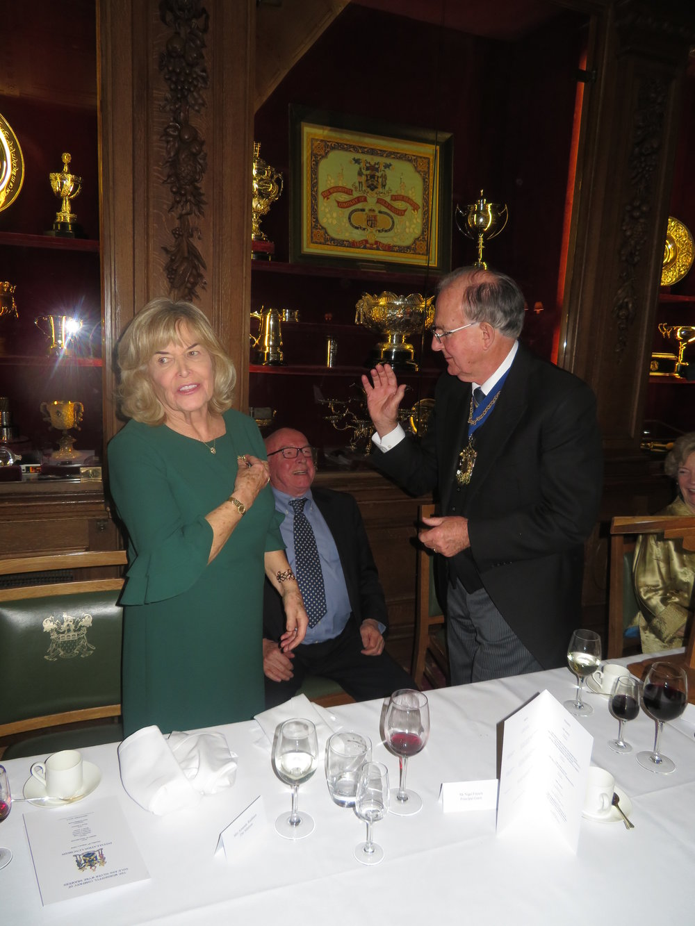 The Mistress receiving her badge from The Master