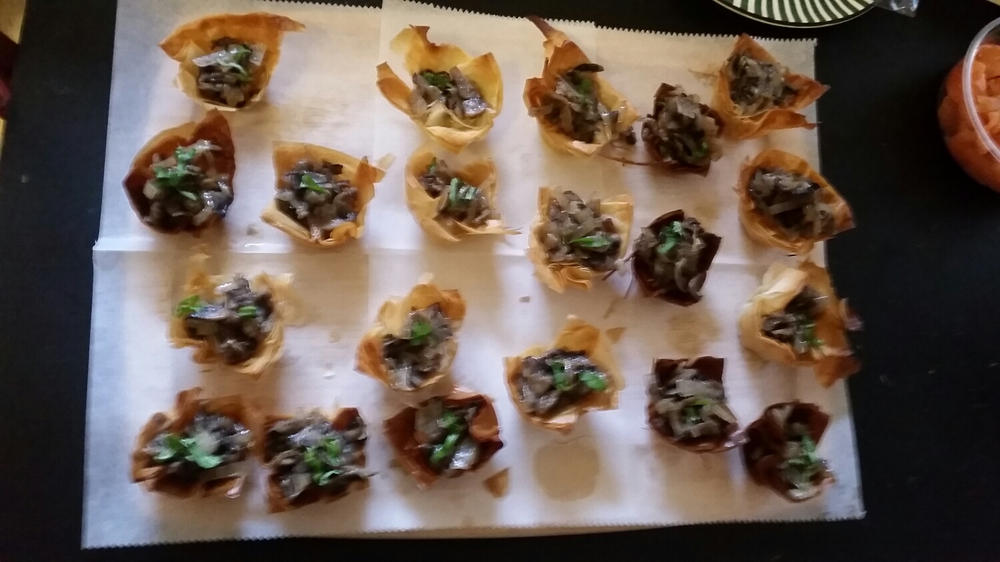 Baked phyllo with sautéed crimini mushrooms and basil.