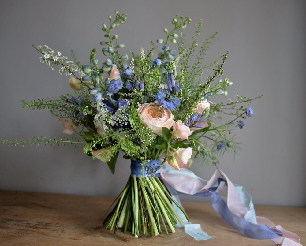A bridal bouquet from April 2016: when the UK poly tunnel grown sweet peas merge with garden bluebells, forget-me-not and spirea.