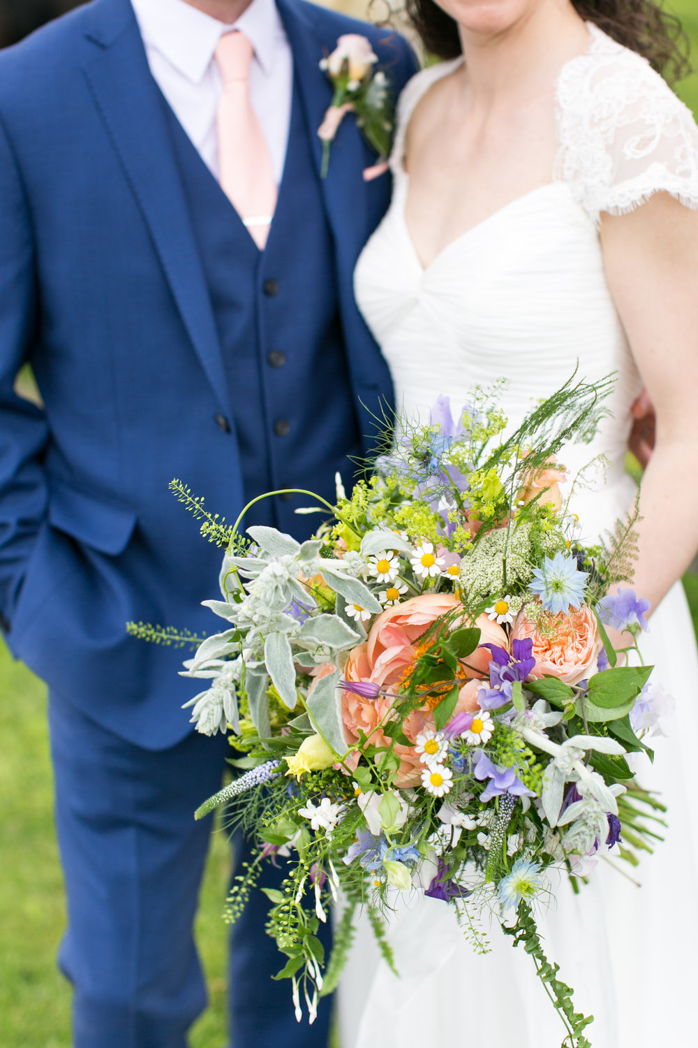 Kerri's hand tied bridal bouquet - bursting with just everything May had to offer. What you can't always appreciate from a photograph is the movement these types of bouquet have. Light and wispy the stems bounce and swish, wafting the most beautiful scents from the trails of jasmine and sweet peas (I still dream about this beautiful ensemble).