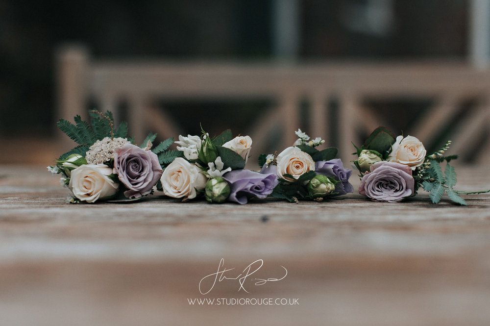 Pretty corsages from this June wedding