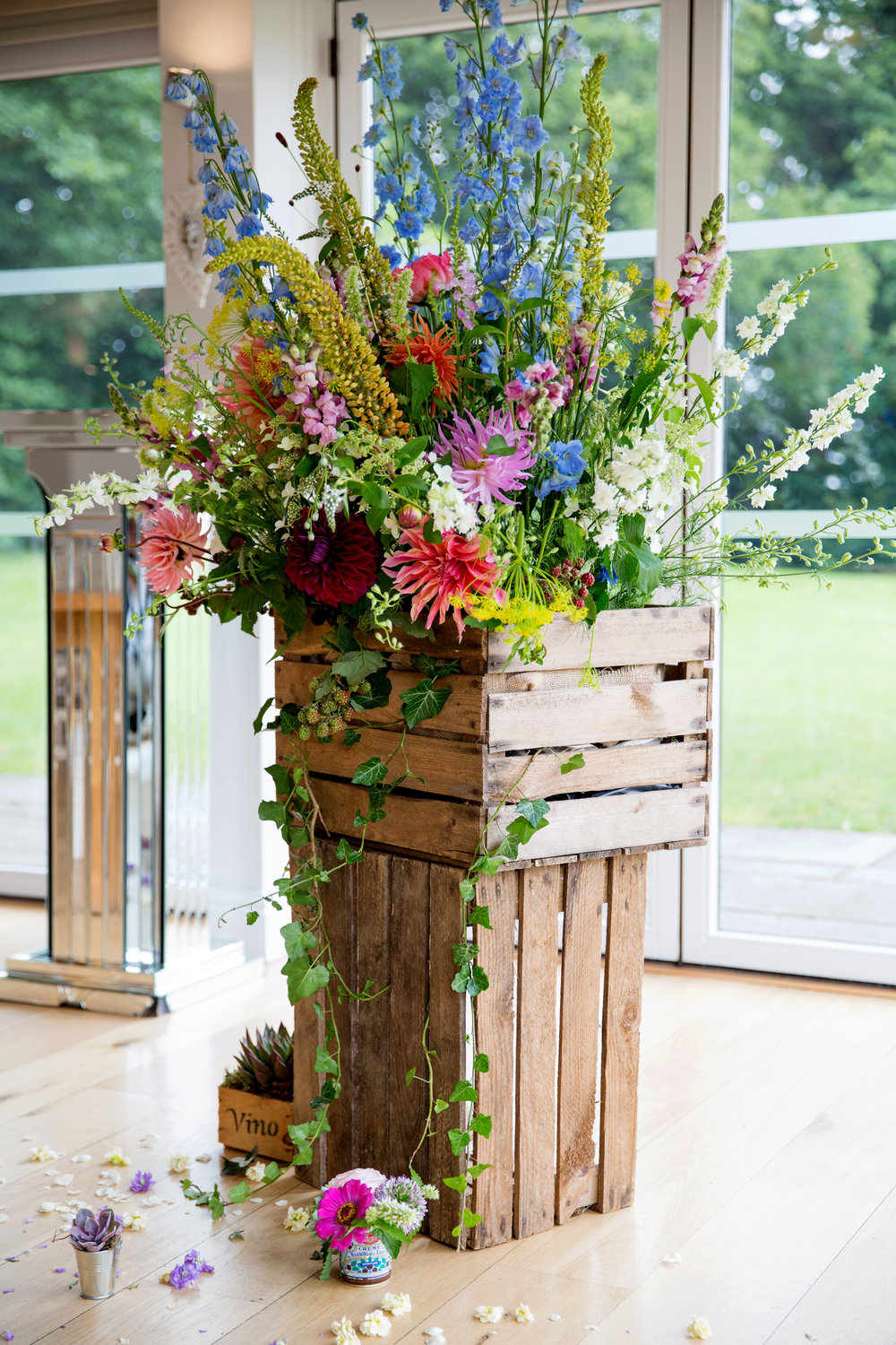 Another atypical ceremony option. Crates of flowers.