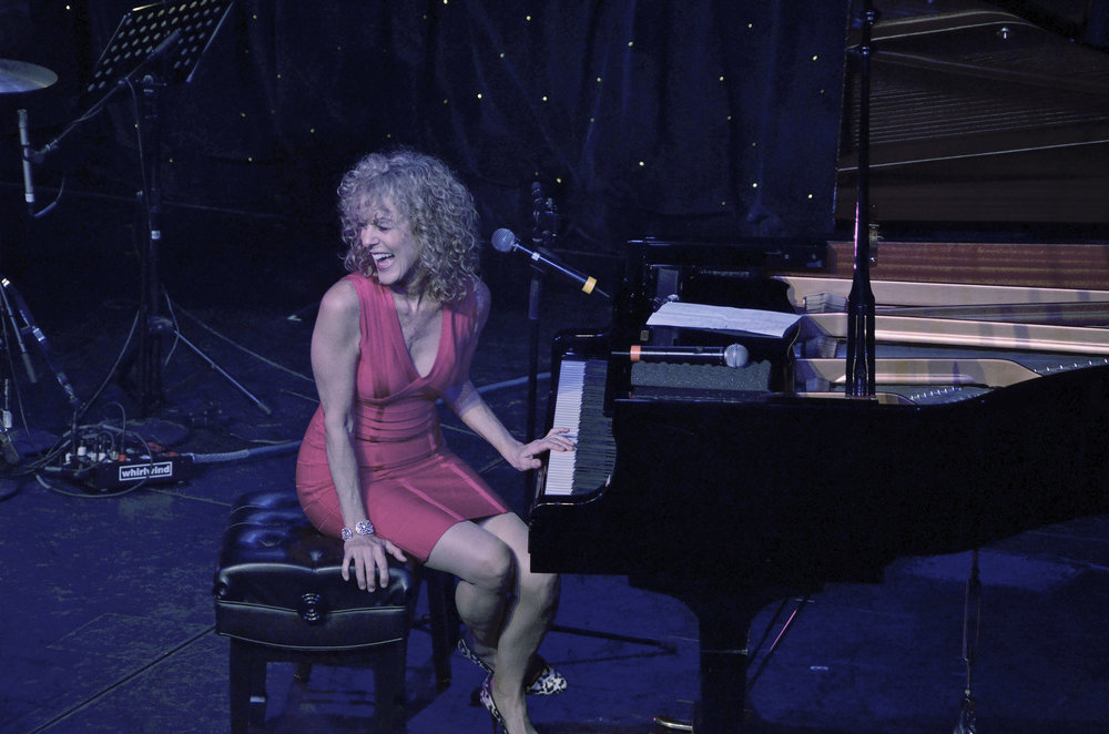 Judy Carmichael laughing-turning at piano High res.jpg
