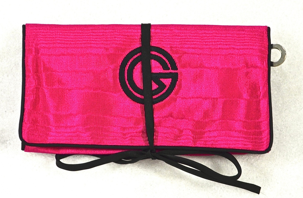 881- Jewel Roll with Detachable Pocket. Shown closed and rolled up in Cerise Moiré with Black Satin Trim.