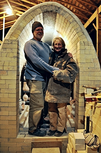 Scott and Debbie loading the Butterfly kiln on a COLD January day.