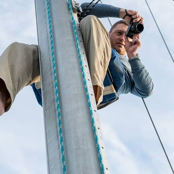 Photographing from the top of a sailboat mast in 2015.