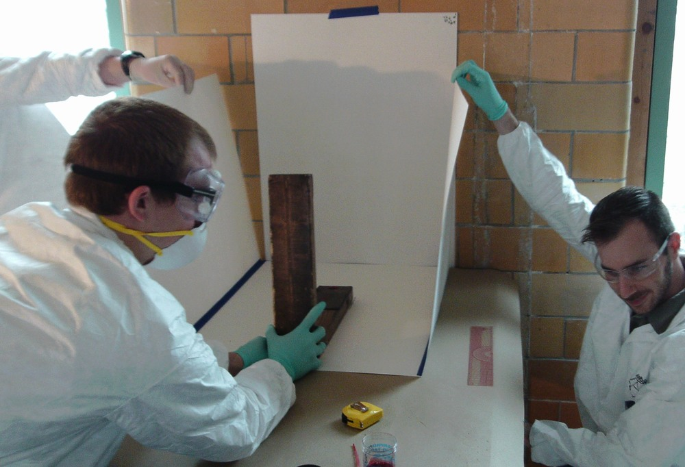 Team conducting experiment on spatter impact patterns.JPG