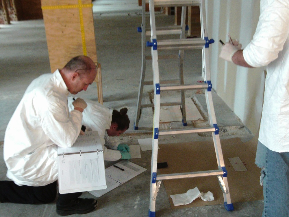 Team dropping blood from known heights and measuring diameters of resulting stains.JPG