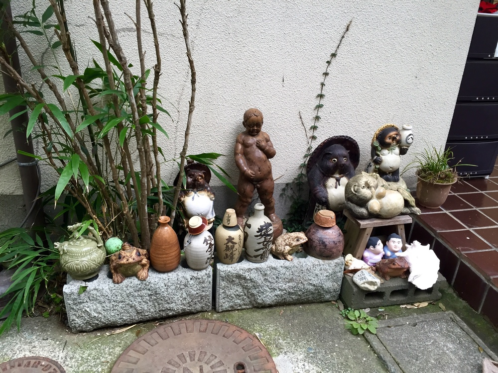Bizarre to say the least...does that tanooki on the far right have breasts? There is a Studio Ghibli film called Pom Poko that's all about these little creatures. I've seen it once, it's not all that good, nor is it directed by Miyazaki, but perhaps I should watch it again.