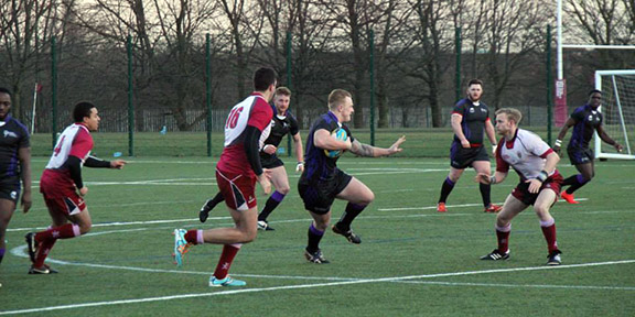 Jack Francis on the charge for Leeds Beckett University